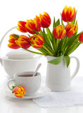 Red tulips and tea Royalty Free Stock Photos