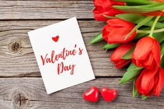 Red tulips and Valentine`s day greeting card royalty free stock image