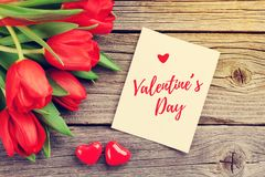 Red tulips and Valentine`s day greeting card royalty free stock photography