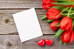 Red tulips and Valentine`s day greeting card stock photo
