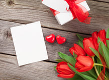 Red tulips, Valentines day card and gift Royalty Free Stock Image
