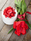Red tulips and valentines day gift box Royalty Free Stock Images