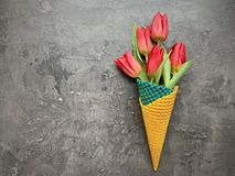 A bouquet of flowers in a waffle cone. stock image