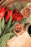 Red tulips in waterdrops with wineglasses. And white wine stock photo