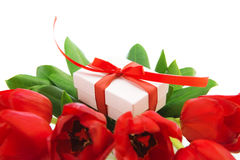 Red tulips and white gift box Royalty Free Stock Photo