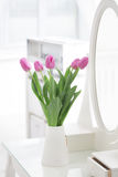 Tulips in room. Red tulips in white room Stock Photo