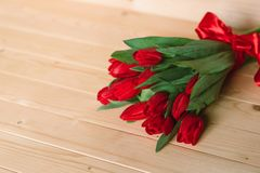 Red tulips on a wooden background. . Colorful Card for Mothers Day, Birthday, International Women`s Day March 8 stock image