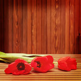 Red tulips on wooden background. Royalty Free Stock Photo