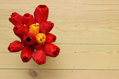 Red tulips on wooden background Stock Image