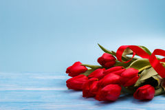 Red tulips on wooden table Royalty Free Stock Photo