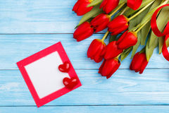 Red tulips on wooden table Royalty Free Stock Photos