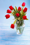 Red tulips on wooden table Royalty Free Stock Photography