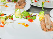 Red tuna and salmon tartar. With mesclun salad & citric foam Stock Image