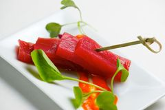 Red tuna view. Red tuna in a small white saucer stock photo