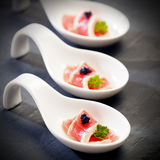 Red tuna on a spoon Royalty Free Stock Images
