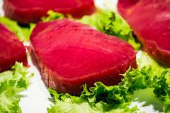 Red tuna steak with lettuce Royalty Free Stock Photos