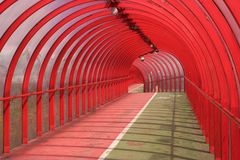 Red Tunnel 2. The red ribbed pedestrian walkway and cycle path in Finnieston, Glasgow, Scotland Stock Photo