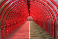 Red Tunnel 4. The red ribbed pedestrian walkway and cycle path in Finnieston, Glasgow, Scotland Stock Photos