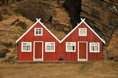 Red turf covered double house, Iceland Stock Photo