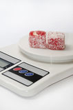 Red turkish delight on the kitchen digital scale Stock Photo