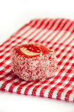 Red turkish delight over red tablecloth Stock Photos