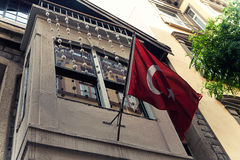 Red turkish flag hanging on a house Stock Image
