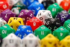 Red Twenty Sided Dice in Mixed Group. A red twenty in the middle of a bunch of random dice Stock Images