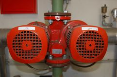 Red twin pump royalty free stock photos
