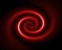 Red twirl. In black space Royalty Free Stock Image