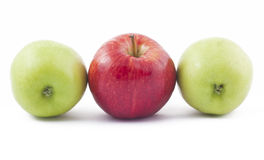 Red and two green apples on white. Background Stock Photo