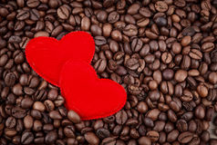 Red two hearts and coffee beans Royalty Free Stock Photo