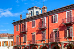 Red two storey building in Alba, Italy. Royalty Free Stock Photo