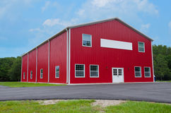 Red two story levels barn with blank sign on front Royalty Free Stock Photos