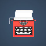Red typewriter isolated on dark blue background Stock Image