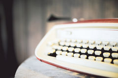 Red typewriter on wooden table Royalty Free Stock Photography