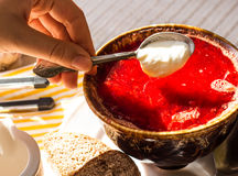 Red Ukrainian borsch, add a teaspoon of sour cream Royalty Free Stock Photos