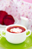 Red Ukrainian borsch soup with sour cream. Stock Photo