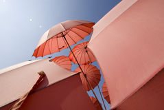 Red umbrella. Some red umbrellas in the sunlight stock image
