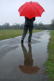 Red umbrella. Man holding red umbrella on a rainy day Stock Photography