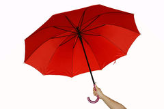 Red umbrella. A hand and a red umbrella Stock Image