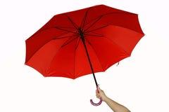 Red umbrella. A hand and a red umbrella stock image