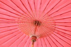 Red umbrella. Close up oriental style handmade paper umbrella royalty free stock photos