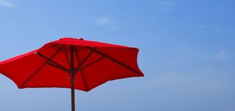 Red Umbrella Against Blue Sky Royalty Free Stock Image