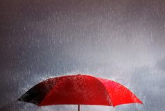 Free Red Umbrella Against The Storm, Sky Background And Black Cloud Group And Rain, Thunderstorm With Savings And Investment, Life And Stock Photography - 157110732