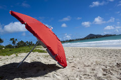 Red umbrella at beach Royalty Free Stock Images
