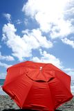 Red umbrella at beach - front view Stock Photography