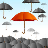 Red Umbrella on Black Fly High. Vector Stock Photos