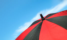 Red umbrella and blue sky Royalty Free Stock Photography