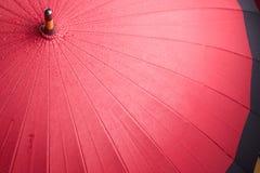 Red umbrella. Bright red opened umbrella. Wet with rainy drops Stock Photos