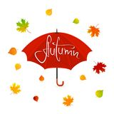 Red umbrella and leaves with lettering Autumn Royalty Free Stock Photography